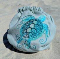 pielucha-otulacz-wełniany-doodush-żółw-tył